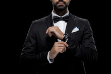 Cropped View Of Businessman In Bow Tie And Tuxedo With Watch, Isolated On Black