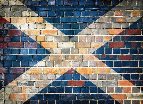 Fényképezés Scotland flag on a brick wall background