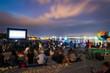 CINEMA ON THE BEACH AT NIGHT