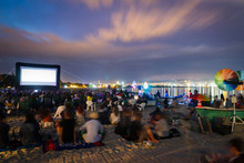 CINEMA ON THE BEACH AT NIGHT