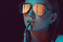 Woman In Sunglasses Drinking S...
