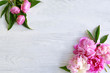 Beautiful peony flowers on wooden background
