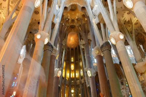 Papiers peints Barcelona Interior illuminated through colorful stained-glass windows. Interior of the Gothic Cathedral. Europe.