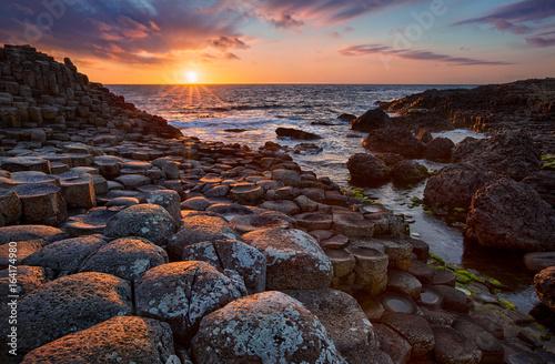 Fotografie, Obraz  sunset over basalt columns Giant's Causeway known as UNESCO World Heritage Site,