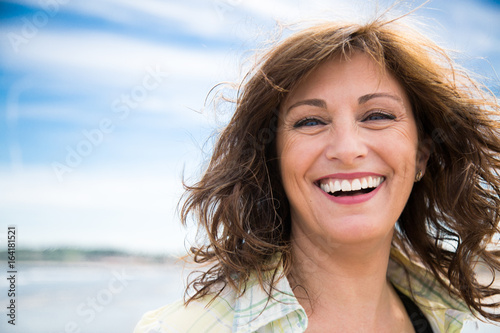 Photographie  Laughing middle aged woman