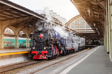 Old Steam Locomotive At An Antique Vintage Train Station