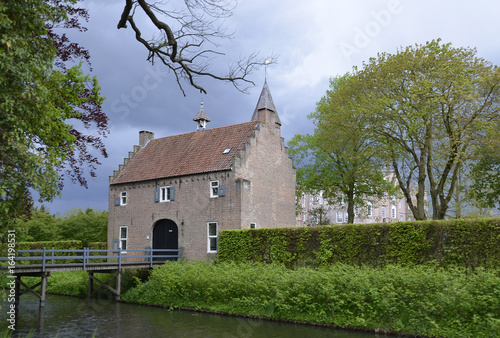 Photo sur Toile Con. Antique Old Castle Type Building with Bridge in The Netherlands, Holland