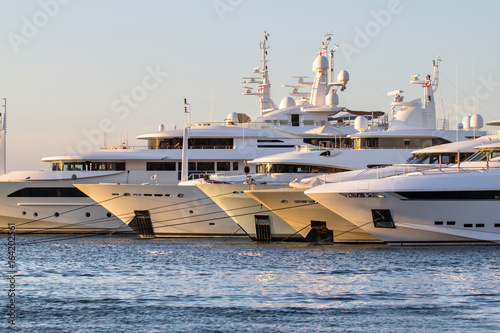 Photo Luxury, rich Yachts moored in a harbor of Porto Cervo