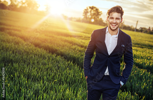 Poster Artist KB Optimistic businessman relaxing on the wheat field