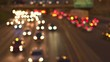 DEFOCUSED BOKEH Cars, SUVs, pickup trucks and semi-trailer trucks caught in traffic jam on busy multiple lane highway through Chicago city at night. Blurry car lights glowing in the dark on expressway