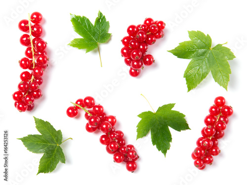 Ripe and juicy red currant with leaves isolated on white background, top view