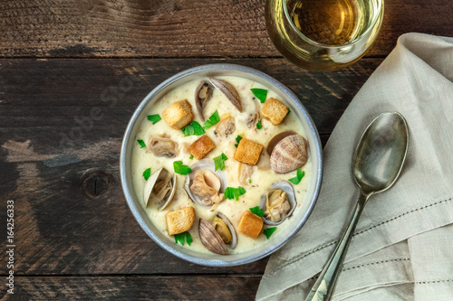 Fotografie, Obraz  Bowl of clam chowder soup, overhead shot, with copy space