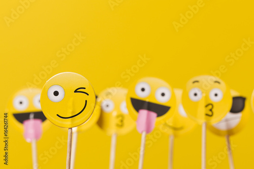 Photo  Emoji smiley social media characters on a yellow background