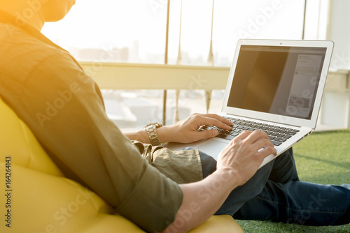 Fotografía  Young man use smartphone and laptop in afternoon, technology lifestyle of new ge