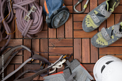 Deurstickers Alpinisme all climbing gear you need on wooden floor.