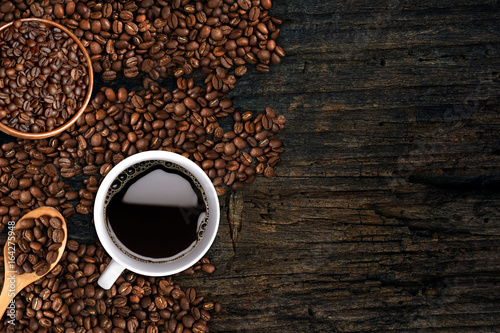 Wall Murals Cafe Coffee background, top view with copy space. White cup of coffee and, ground coffee, coffee beans on dark wooden background