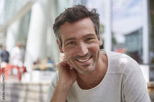 Portrait of smiling man at an outdoor cafe