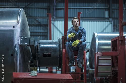 Worker having a break in factory