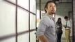asian entrepreneur walking around office thinking