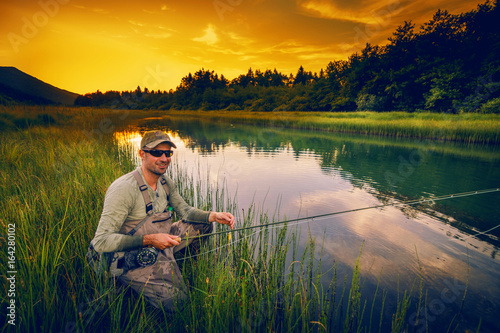 Printed kitchen splashbacks Fishing Fly fisherman fishing pike in river