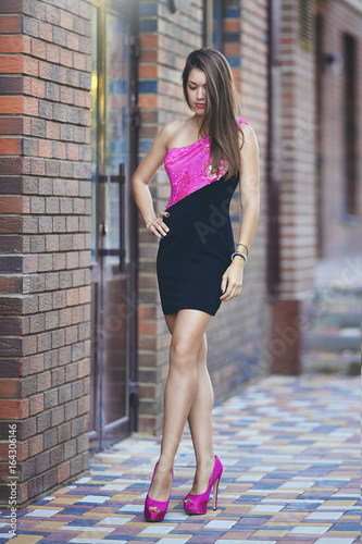 Beautiful Sexy Girl With Long Hair In Short Pink Black Dress On High