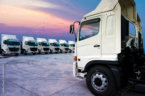 New truck fleet is parking and sunset background. Canvas Print