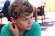 Young boy thoughtful and feeling lonely