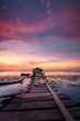Beautiful colorful sunrise view of wooden and vintage jetty at Jelutong, Penang, Malaysia.