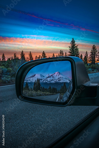 Reflection in rear view mirror of mountain sunset Wallpaper Mural