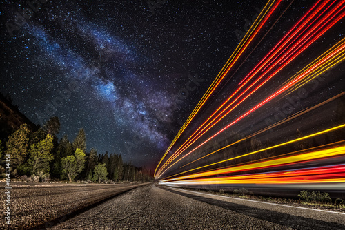 Foto op Aluminium Nacht snelweg Light streaks on the highway under the Milky Way
