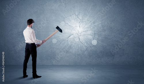 Fotografie, Obraz  Business man hitting wall with a hammer