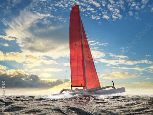trimaran-z-czerwonym-zaglem-na-otwartym-morzu