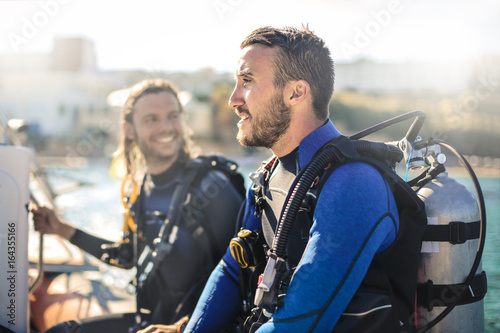 Spoed Foto op Canvas Duiken Scuba diver on a boat having fun