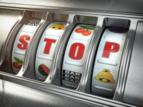 фотография  Stop gambling addiction concept. Slot machine with text stop.