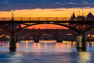 Fototapeta na wymiar Sunrise on the Pont des Art, Pont Neuf and the Seine River Banks. 1st Arrondissement, Paris, France