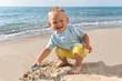 Summer ,day,beach, boy playing in sand