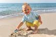 Summer ,day,beach, boy playing in sand