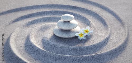 Acrylic Prints Stones in Sand Steinturm auf Sandwellen mit Frangipani-Blüten