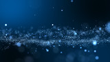 Dark blue and glow particle abstract background.