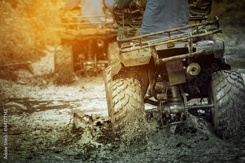 Photo Stands Motor sports action shot of sport atv vehicle running in mud track