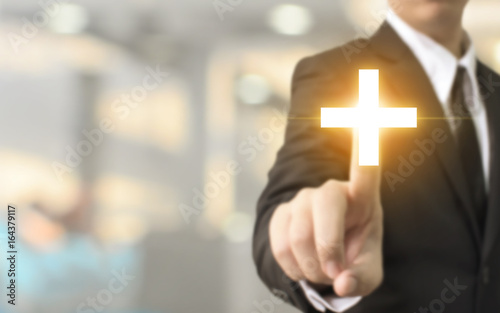 Fototapeta Businessman hand touching plus sign with blurred background, Business offer positive, benefit and development concept obraz