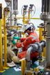 Technician, pump man or machanic technician on the job un blog suction of pump in oil and gas process platform