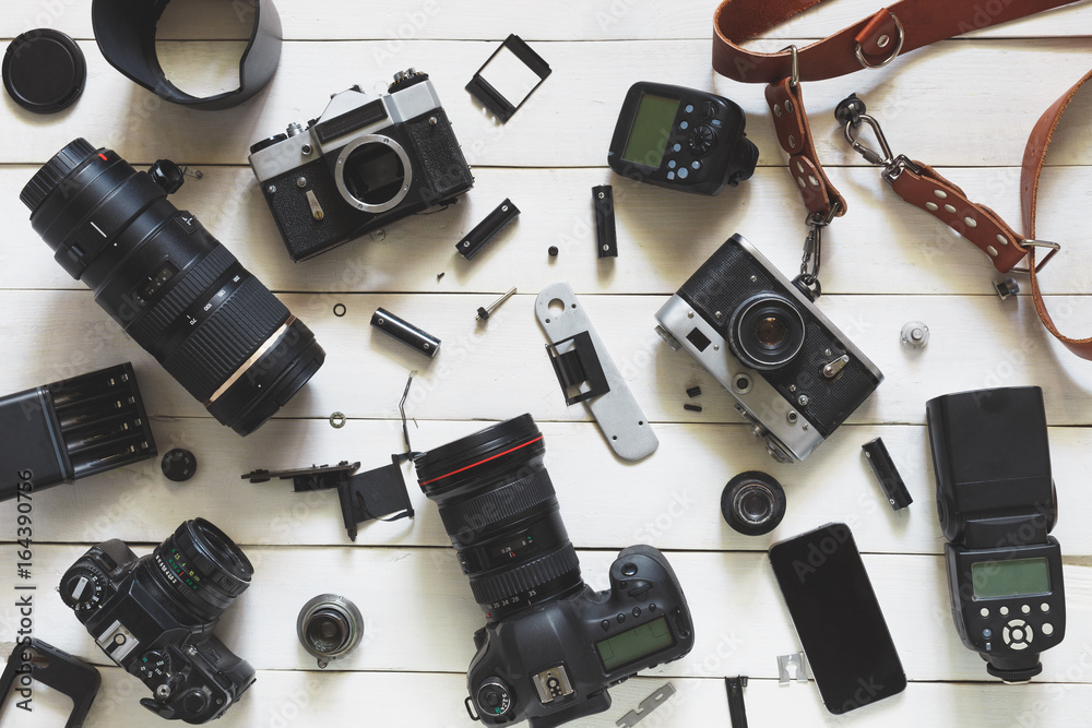 Fototapety, obrazy: Photographer Workplace, Camera, Lenses And Accessories On White Wooden Background. Top View