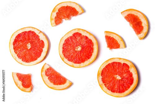 Grapefruit slices isolated on white background