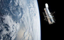 Hubble Space Telescope Orbiting Planet Earth (3d Rende)