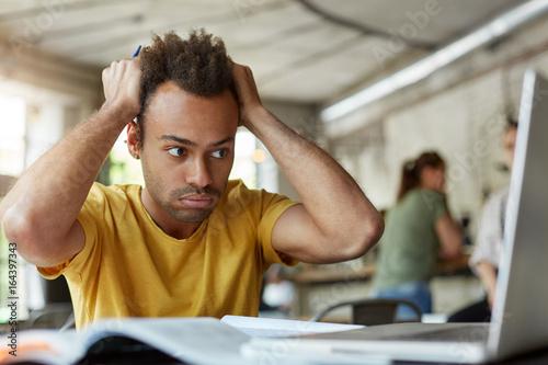 Stressed young African American student of school of economics feeling frustrate Tapéta, Fotótapéta
