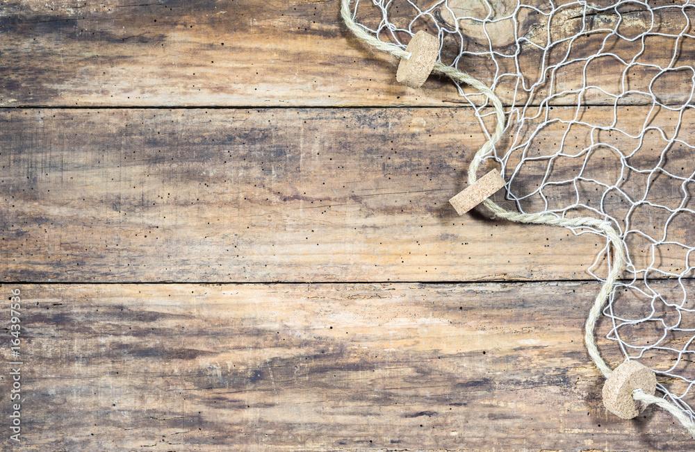 Fototapety, obrazy: Fischer Netz auf Holz Hintergrund mit Textfreiraum