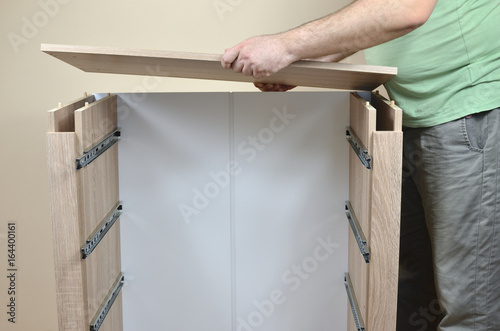 Assembling Parts Of A New Dresser With Drawer Rails Buy This Stock