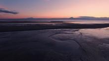 A Tranquil Midnight Sun Illumi...