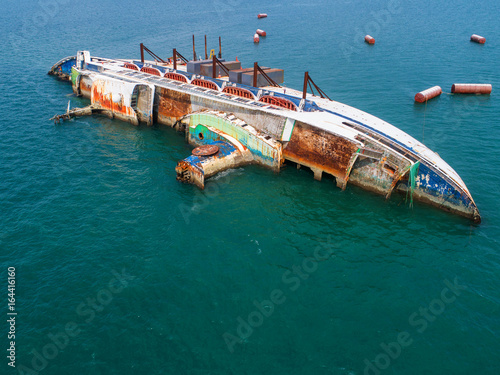Photo Stands Ship Boat crashes in the sea, cruise ship ,accident ,Shipwreck